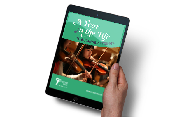 "Cover of ""A Year in the Life of Beginner Strings"" free e-book displayed on a tablet"